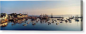 Tall Ships At A Harbor At Sunrise Canvas Print by Panoramic Images