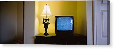 Television And Lamp In A Hotel Room Canvas Print by Panoramic Images