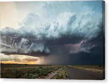 Thunderstorm At Sunset Canvas Print by Roger Hill