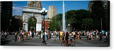 Tourists At A Park, Washington Square Canvas Print by Panoramic Images