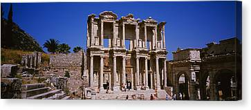Tourists In Front Of The Old Ruins Canvas Print by Panoramic Images