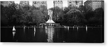 Toy Boats Floating On Water, Central Canvas Print by Panoramic Images