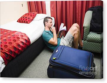 Travelling Man Holding Travel Itinerary Canvas Print by Jorgo Photography - Wall Art Gallery