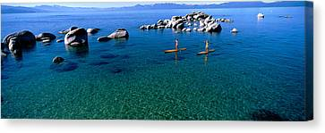 Two Women Paddle Boarding In A Lake Canvas Print by Panoramic Images
