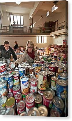 Volunteers At A Food Bank Canvas Print by Jim West