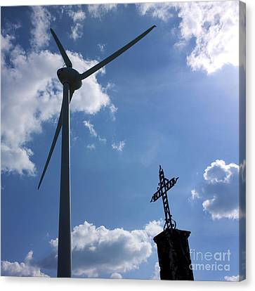Wind Turbine And Cross Canvas Print by Bernard Jaubert