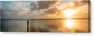 Woman Standing On Sandbar Looking Canvas Print by Panoramic Images