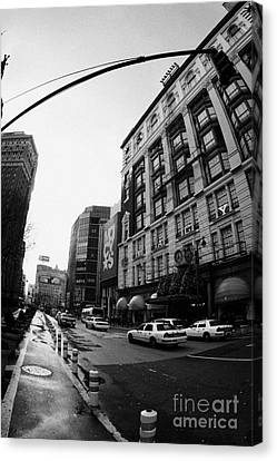 yellow cabs wait outside Macys at Broadway and 34th Street Herald Square new york Canvas Print by Joe Fox