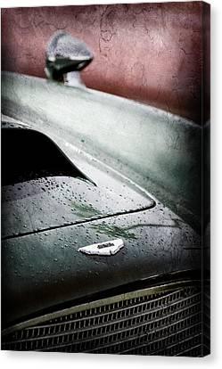 1959 Aston Martin Db4 Gt Hood Emblem Canvas Print by Jill Reger