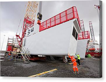 Parts For The Walney Offshore Wind Farm Canvas Print by Ashley Cooper