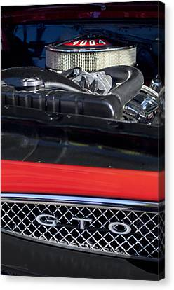 1967 Pontiac Gto Engine Emblem Canvas Print by Jill Reger