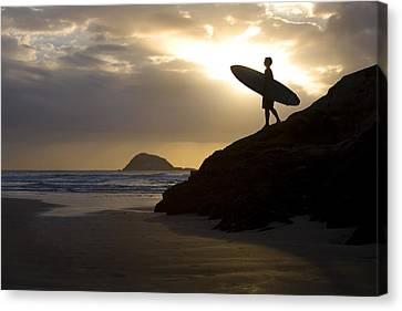 A Surfer On Muriwai Beach New Zealand Canvas Print by Deddeda