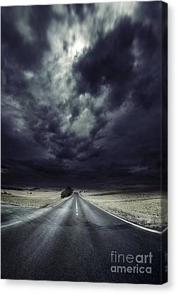 An Asphalt Road With Stormy Sky Above Canvas Print by Evgeny Kuklev