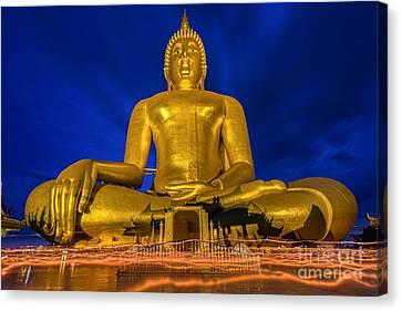 Candlelight Makha Bucha Day At Wat Muang  Canvas Print by Anek Suwannaphoom