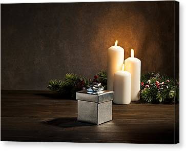 Candles Present In Christmas Setting Canvas Print by Ulrich Schade