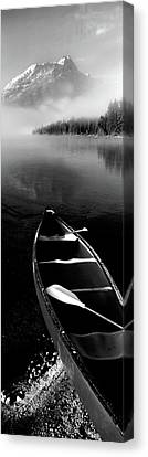 Canoe In Lake In Front Of Mountains Canvas Print by Panoramic Images