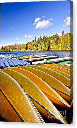 Canoes On Autumn Lake Canvas Print by Elena Elisseeva