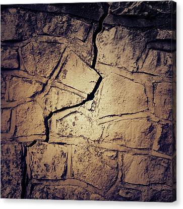 Cracked Wall Canvas Print by Les Cunliffe