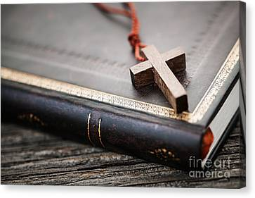 Cross On Bible Canvas Print by Elena Elisseeva