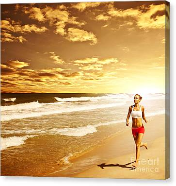 Healthy Woman Running On The Beach Canvas Print by Anna Omelchenko