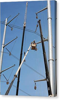 High Voltage Power Line Construction Canvas Print by Jim West