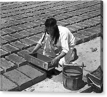 Indians Making Adobe Bricks Canvas Print by Underwood Archives