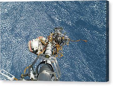 Iss Spacewalk Canvas Print by Nasa