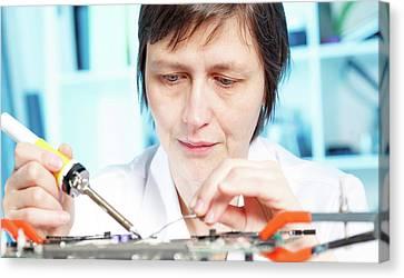Lab Assistant Working On Circuit Board Canvas Print by Wladimir Bulgar