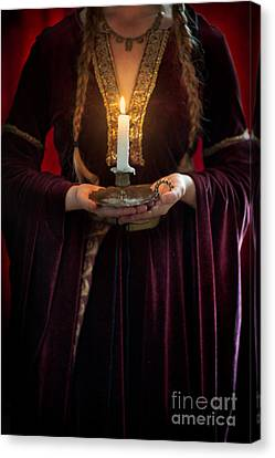 Medieval Woman Holding A Candle Canvas Print by Lee Avison