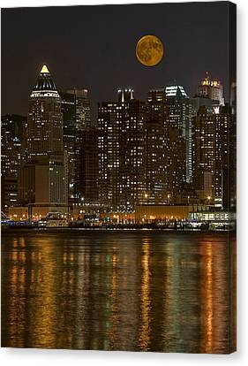 Moonrise Over Manhattan Canvas Print by Susan Candelario