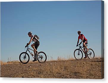 Mountain Bikers Canvas Print by Jim West