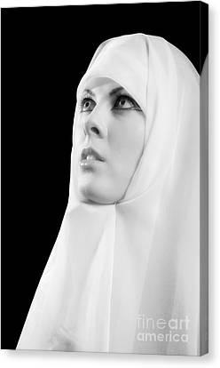 Nun Praying Canvas Print by Aleksey Tugolukov