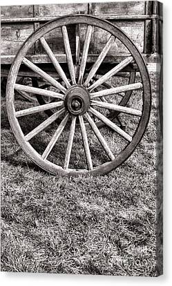 Old Wagon Wheel On Cart Canvas Print by Olivier Le Queinec