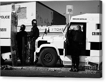 Psni Officers In Protective Riot Gear At Landrovers On Crumlin Road At Ardoyne Shops Belfast 12th Ju Canvas Print by Joe Fox