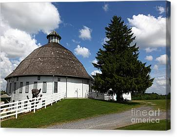 Round Barn Canvas Print by James Brunker