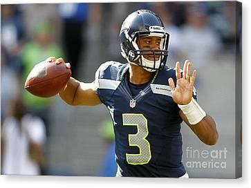 Russell Wilson Canvas Print by Marvin Blaine