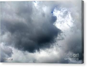 Storm Clouds Canvas Print by J McCombie