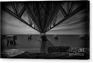 Under The Pier Canvas Print by James Dean