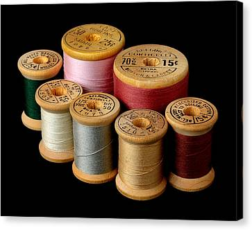 Wooden Spools Canvas Print by Jim Hughes