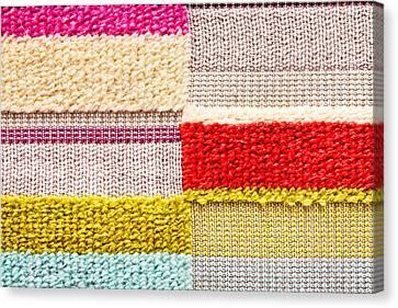 Colorful Textile Canvas Print by Tom Gowanlock