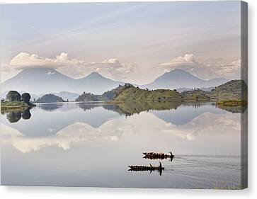Dugout Canoe Floating On Lake Mutanda Canvas Print by Martin Zwick