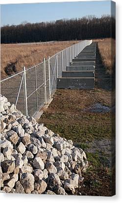 Fence Blocking Invasive Fish Species Canvas Print by Jim West