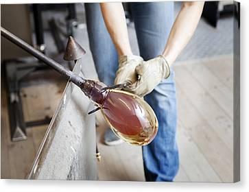 Glassblower At Work Canvas Print by Thomas Fredberg