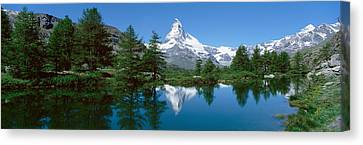 Reflection Of A Mountain In A Lake Canvas Print by Panoramic Images