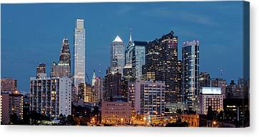 Skyscrapers In A City At Dusk Canvas Print by Panoramic Images
