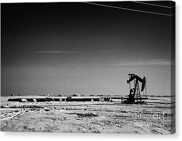 snow covered prairie agricultural farming land with pumpjacks oilfield winter Forget Saskatchewan Ca Canvas Print by Joe Fox