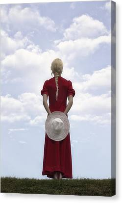 Woman In Red Canvas Print by Joana Kruse