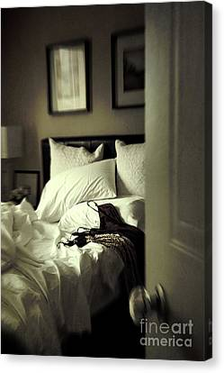 Bedroom Scene With Under Garments On Bed Canvas Print by Sandra Cunningham