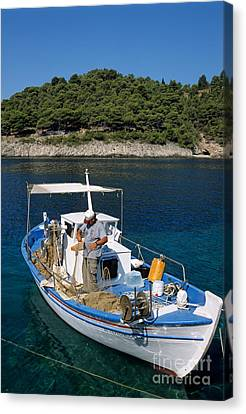 Fisherman In Asos Village Canvas Print by George Atsametakis