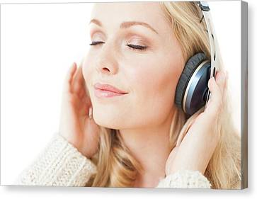 Woman Wearing Headphones Canvas Print by Ian Hooton